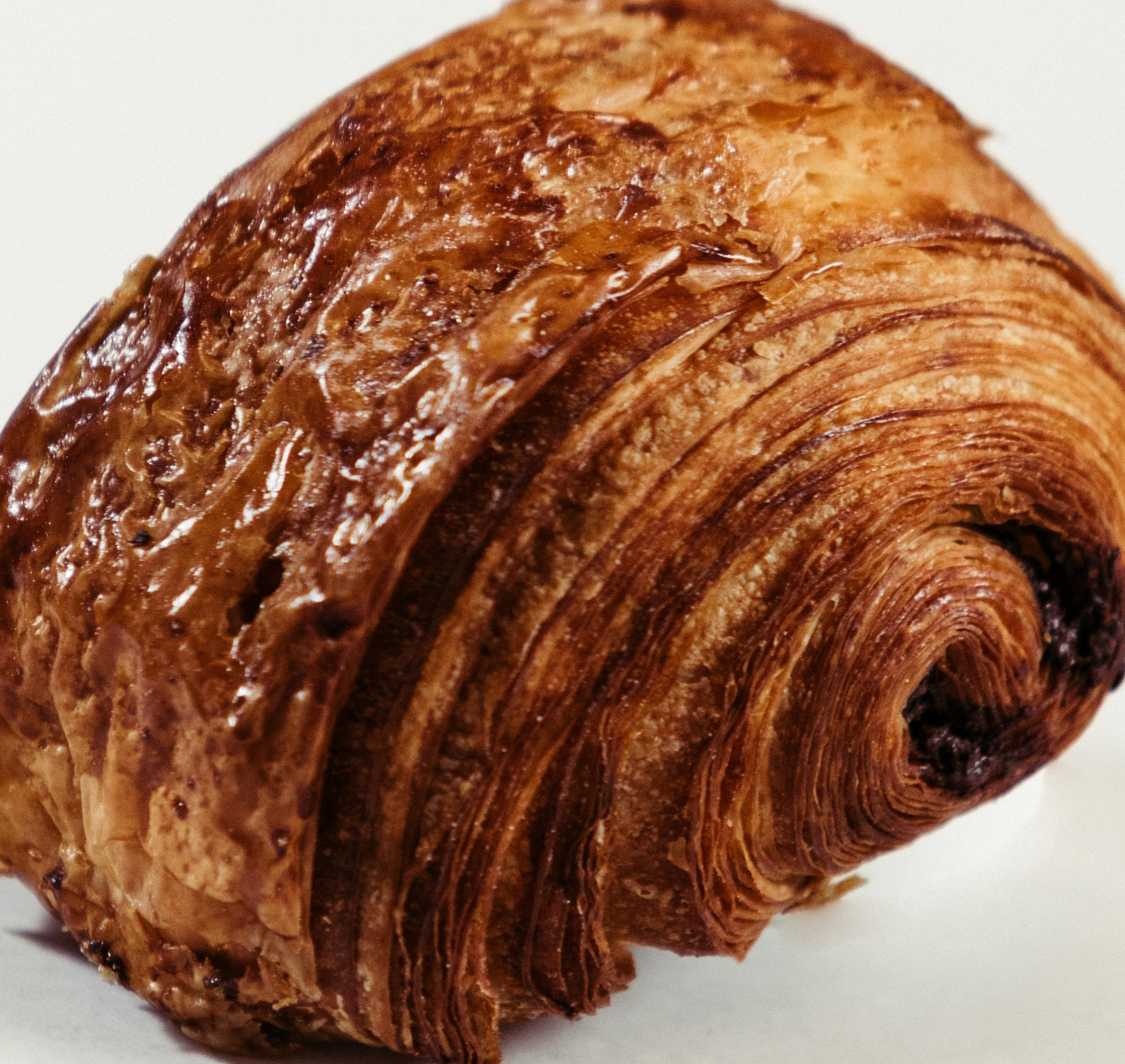 """Pain Au Chocolat  with the addition of Valrhona chocolate sticks. The best bit is the """"snout"""" that is made when the chocolate melts out of the ends during baking."""