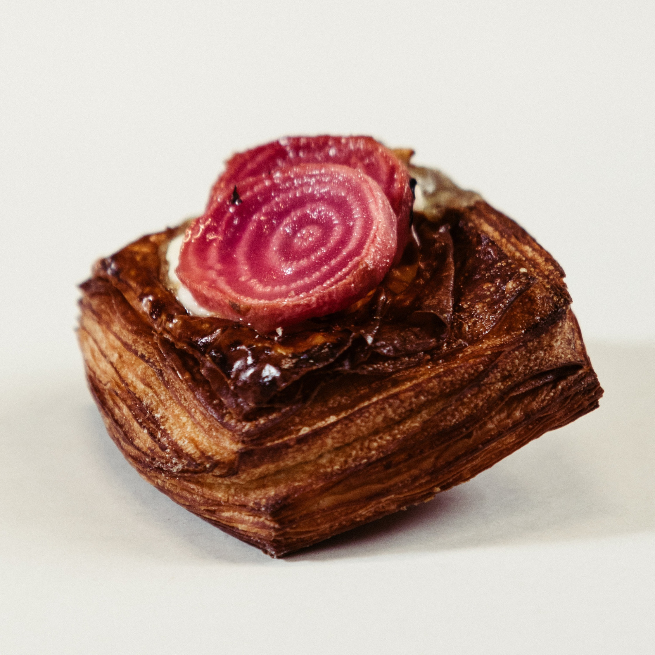Savoury Danish  Seasonal fruit or veg, often on a bed of  cheese. The example above shows candied beetroot & ricotta.