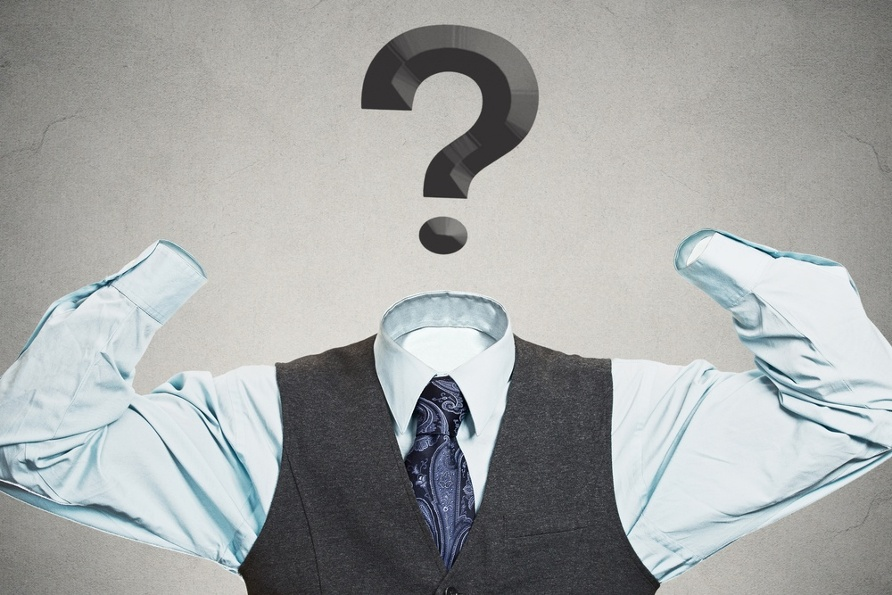 Desperate businessman with question mark instead of head has no hands tools to solve multiple financial issues isolated grey wall background. Corporate problems lack of solutions concept. Hopelessness.jpeg