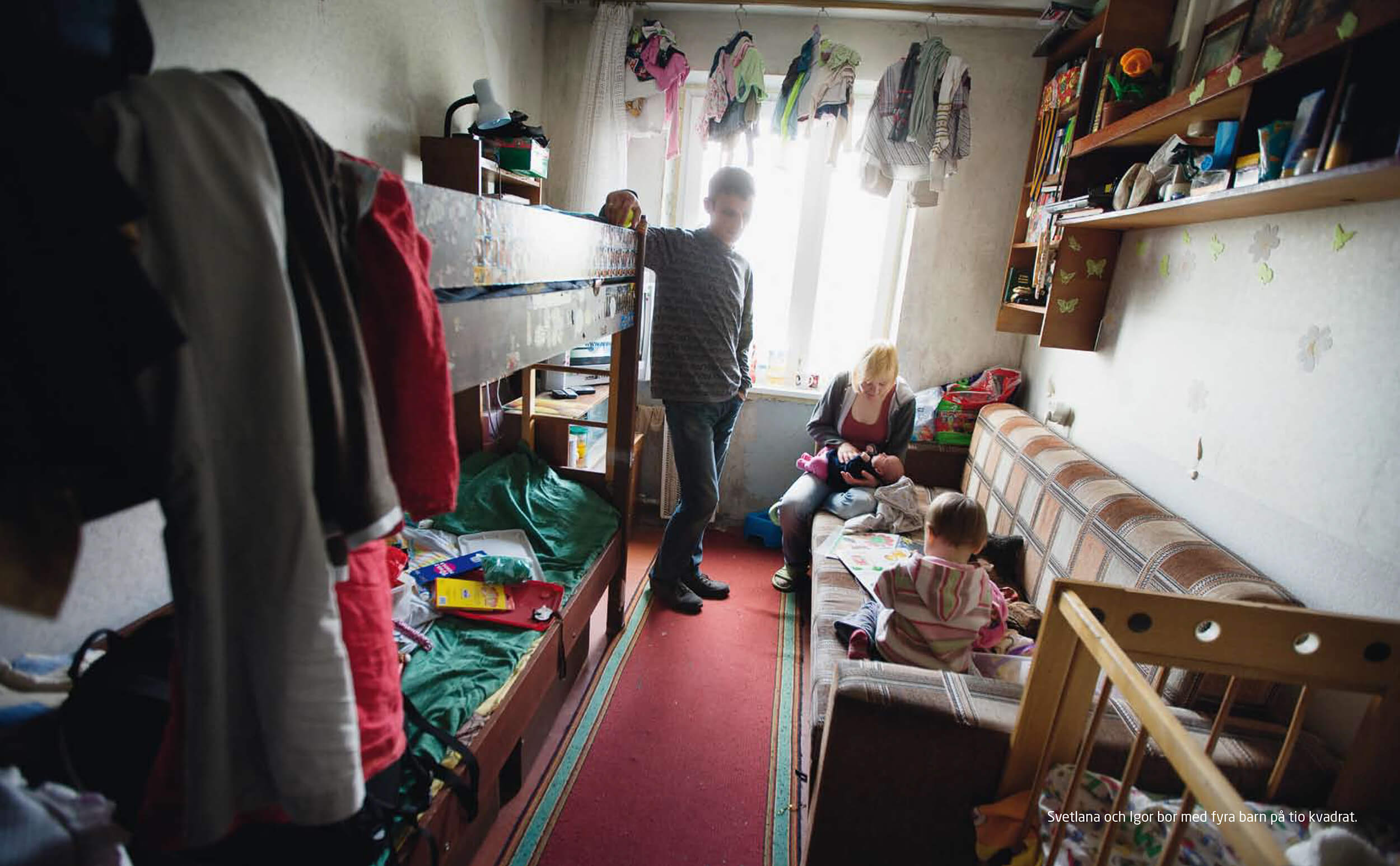 Ukraine. Svetlana, mother of four children has diagnosed HIV, lives with her new man, Igor at ten square meters