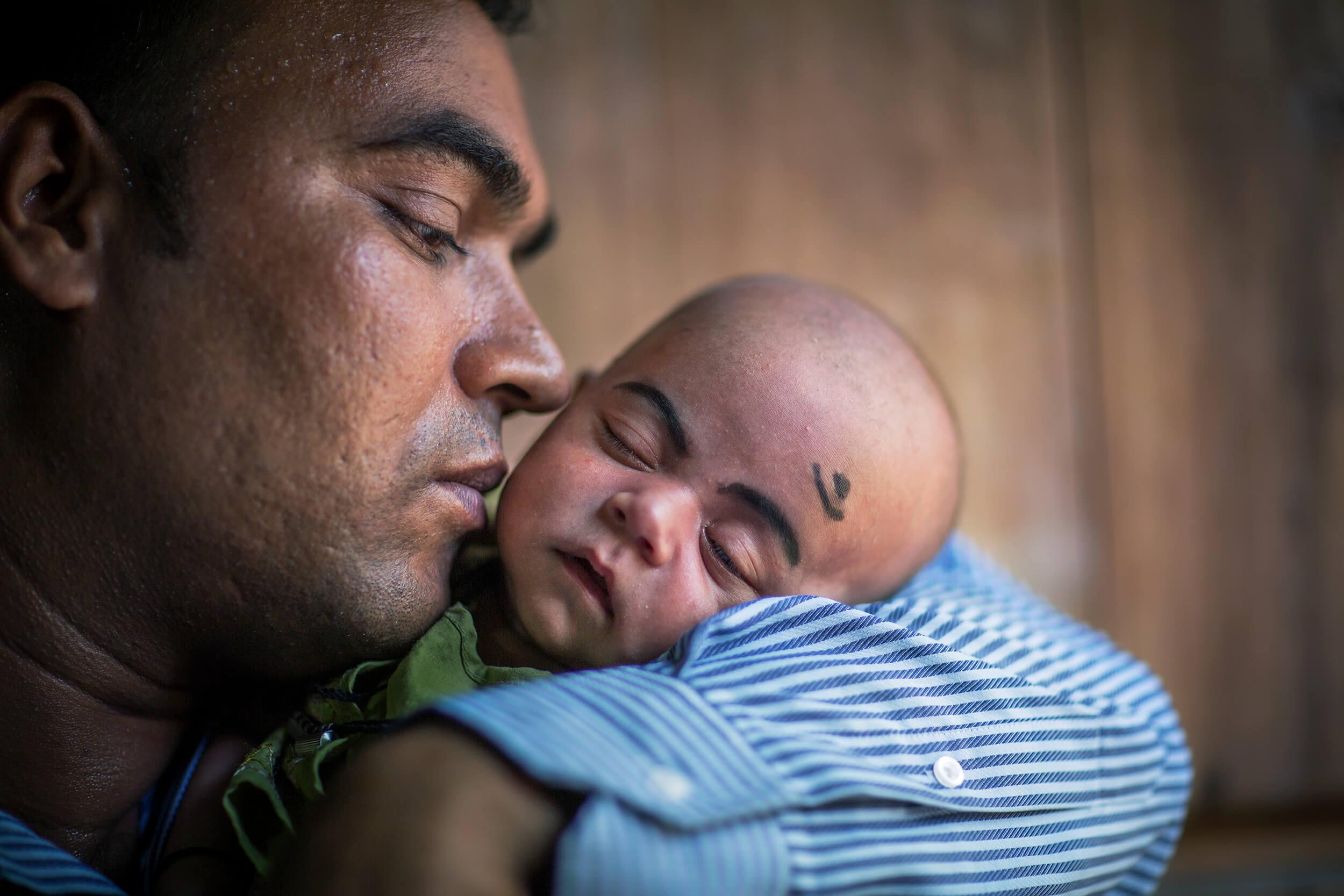 Bangladesh. Sajid Khan with his son Nasid Khan.