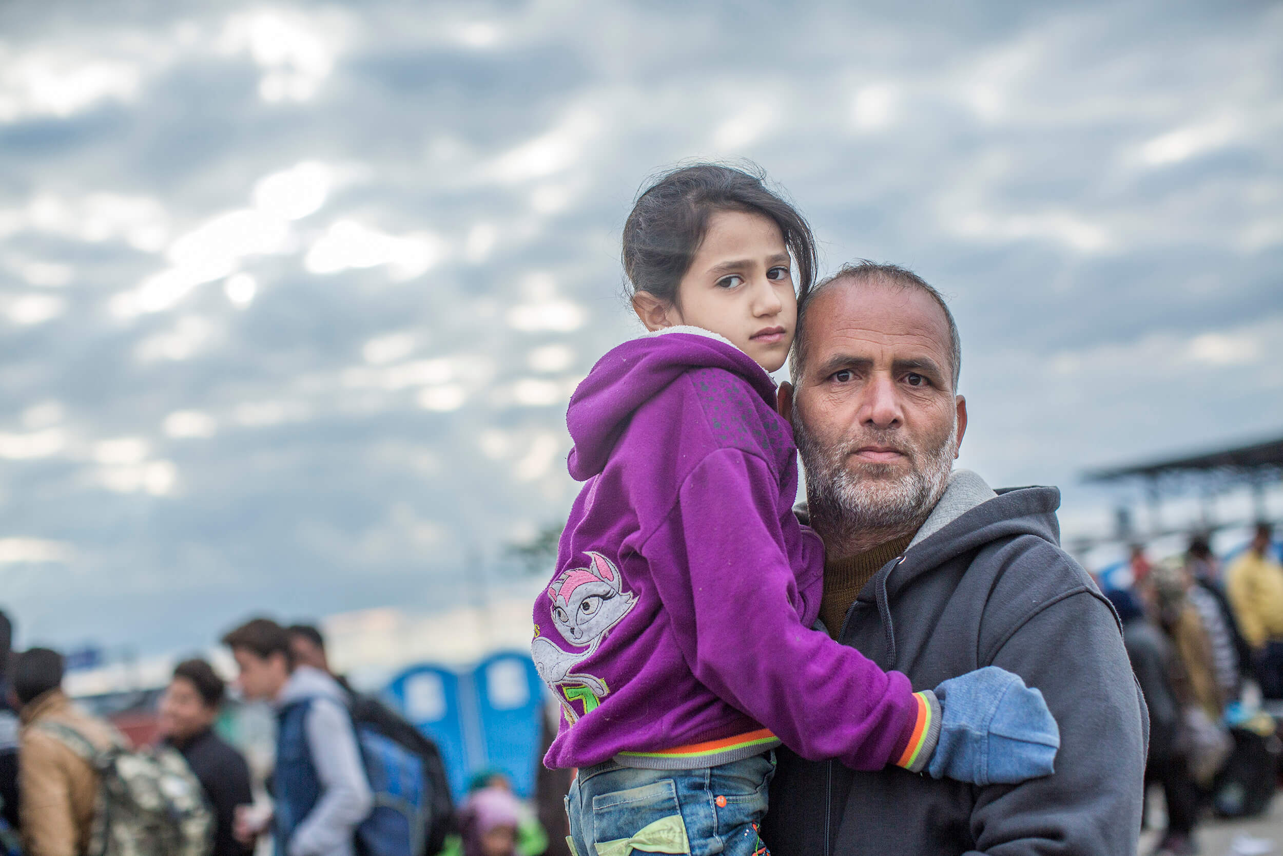 Austria, Nickelsdorf. October 2015.Nidal Awad, from Syria. Refugees from Syria, Afghanistan and Iraq arrive by train with his daughter to the Hungarian border station Hegyeshalom.