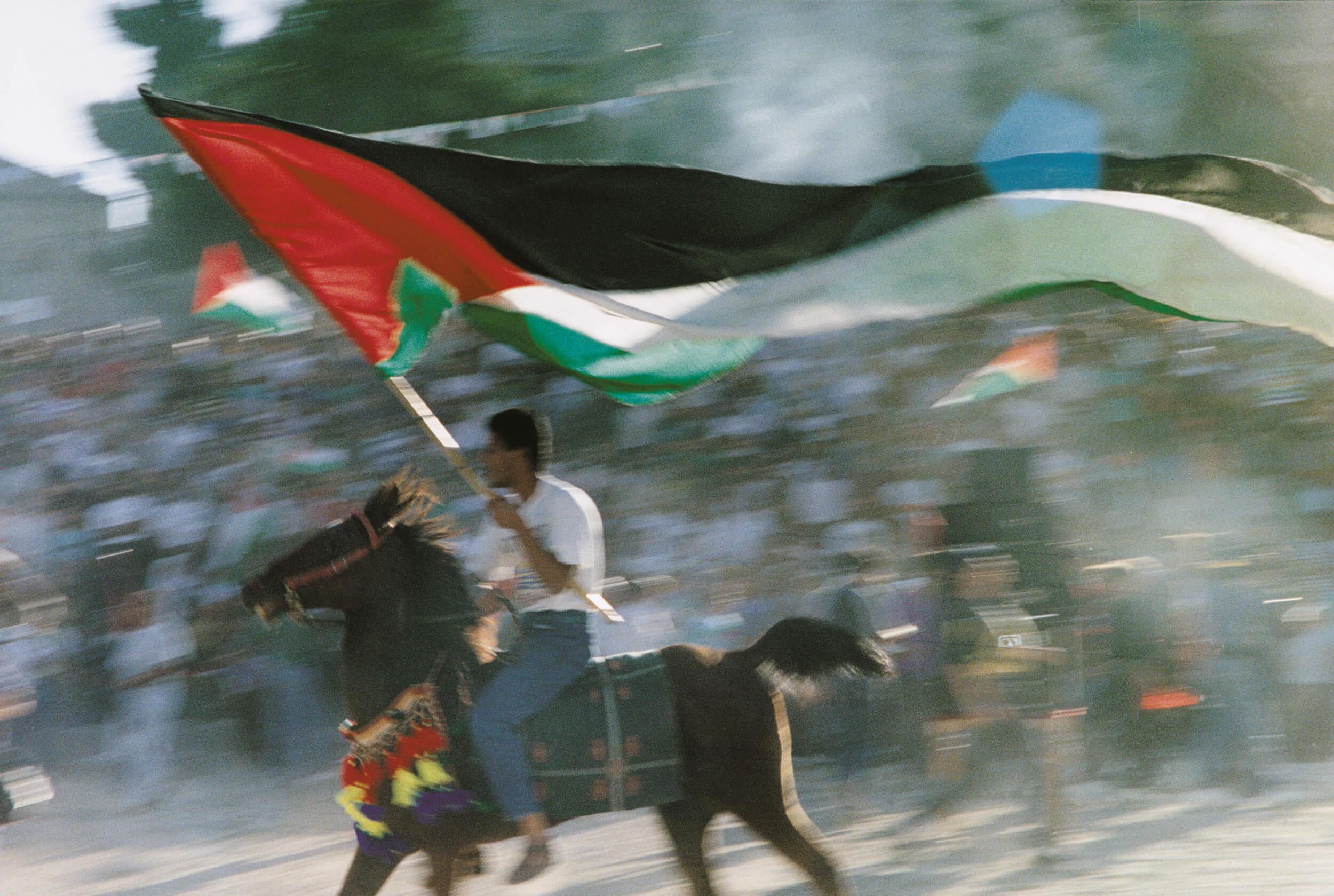 Jerusalem. Palestinians celebrate the Oslo agreement on September 13, 1993.