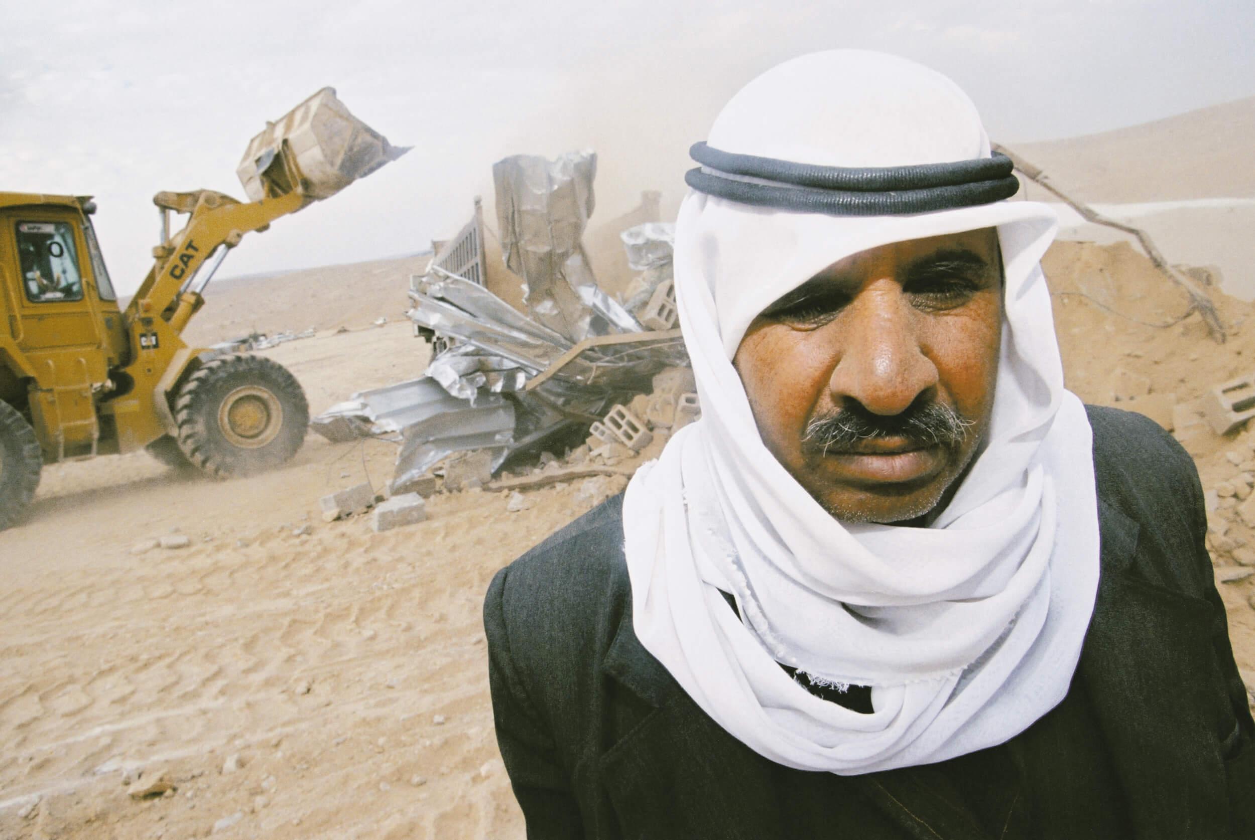 Israeli authorities demolish Bedouin's house.