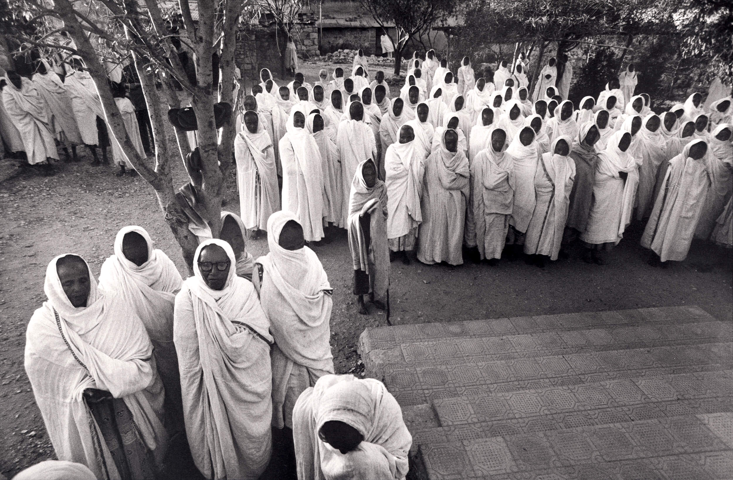 Christian orthodox ceremony in the dawn during the war. Adi Qaie, Eritrea 1990.