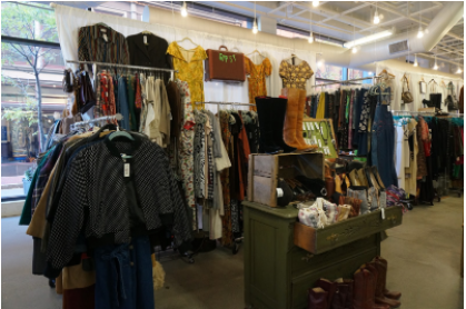 A full view of Meteer's collection, Gypsy, which includes vintage jackets, leather boots, and '70s peasant dresses
