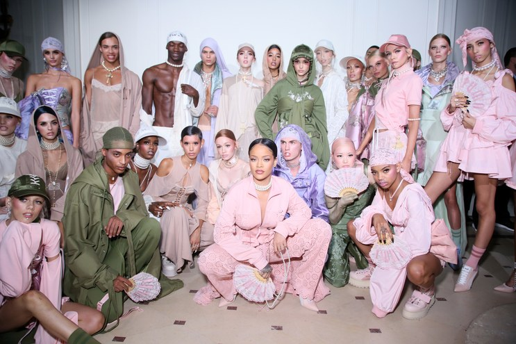 Rihanna backstage with models at Fenty x Puma Runway Show  Photo from Getty Images