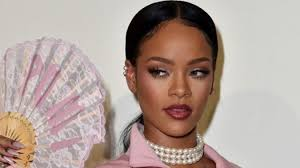 Rihanna poses with Fenty X Puma fan  Photo from Getty Images