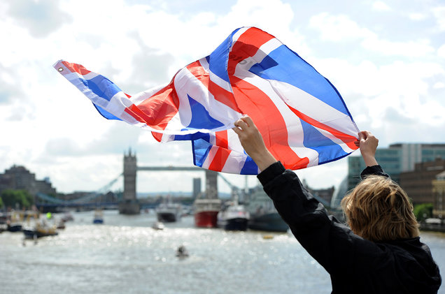 A leave supporter is seen as fishing boats campaigning for Brexit sail down the Thames through central London on June 15, 2016. Source:  billboard.com