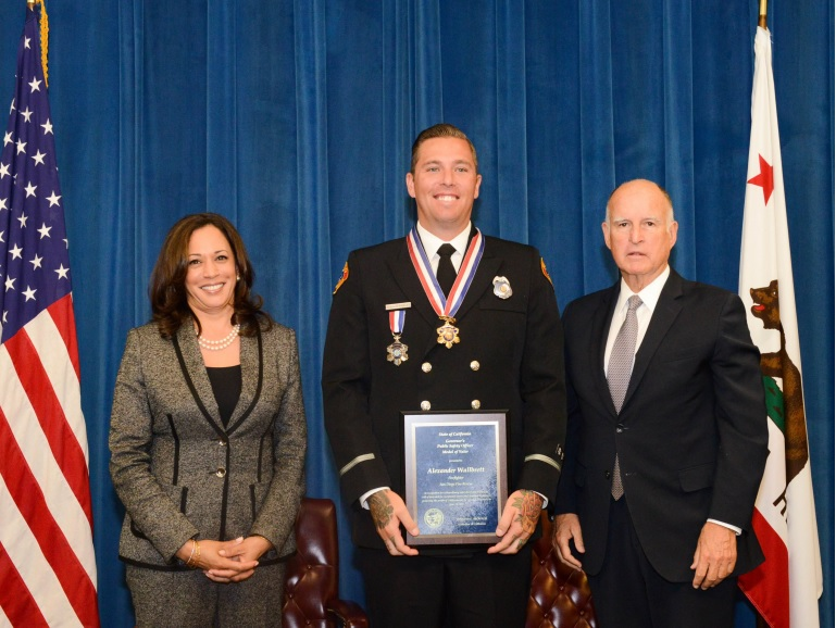 Governor Brown and Attorney General Harris with San Diego Fire-Rescue Department Firefighter Alexander Wallbrett.Photo Credit: Dionne Grubbs, California Department of Justice.