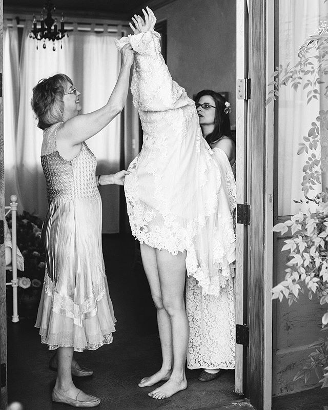My all time favorite getting ready photo! Lara slipping into her dress with a little help from mama. (So wishing Instagram didn't make me crop this)