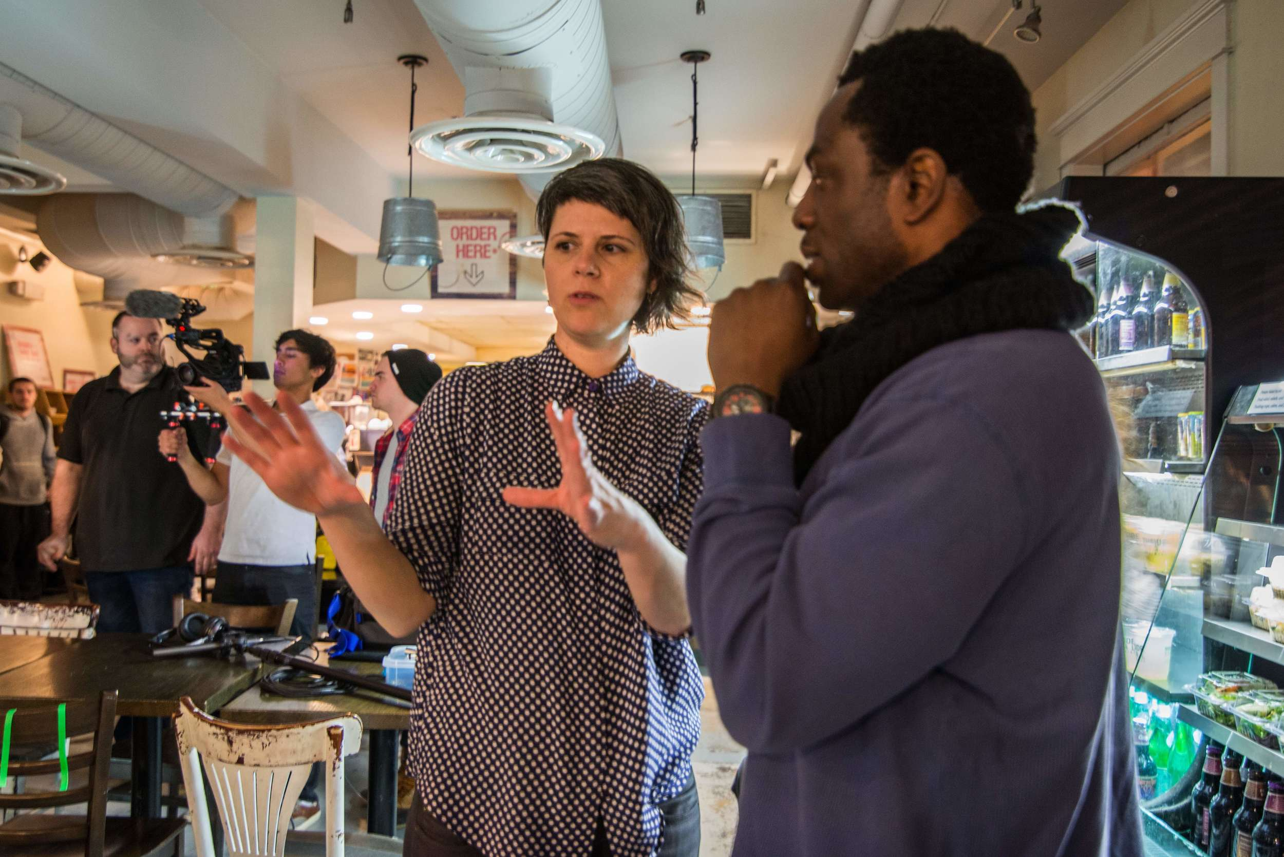 Chesler and Charles consider the next shot on location at Northside Social in Arlington, VA. Image by Dixie D. Vereen