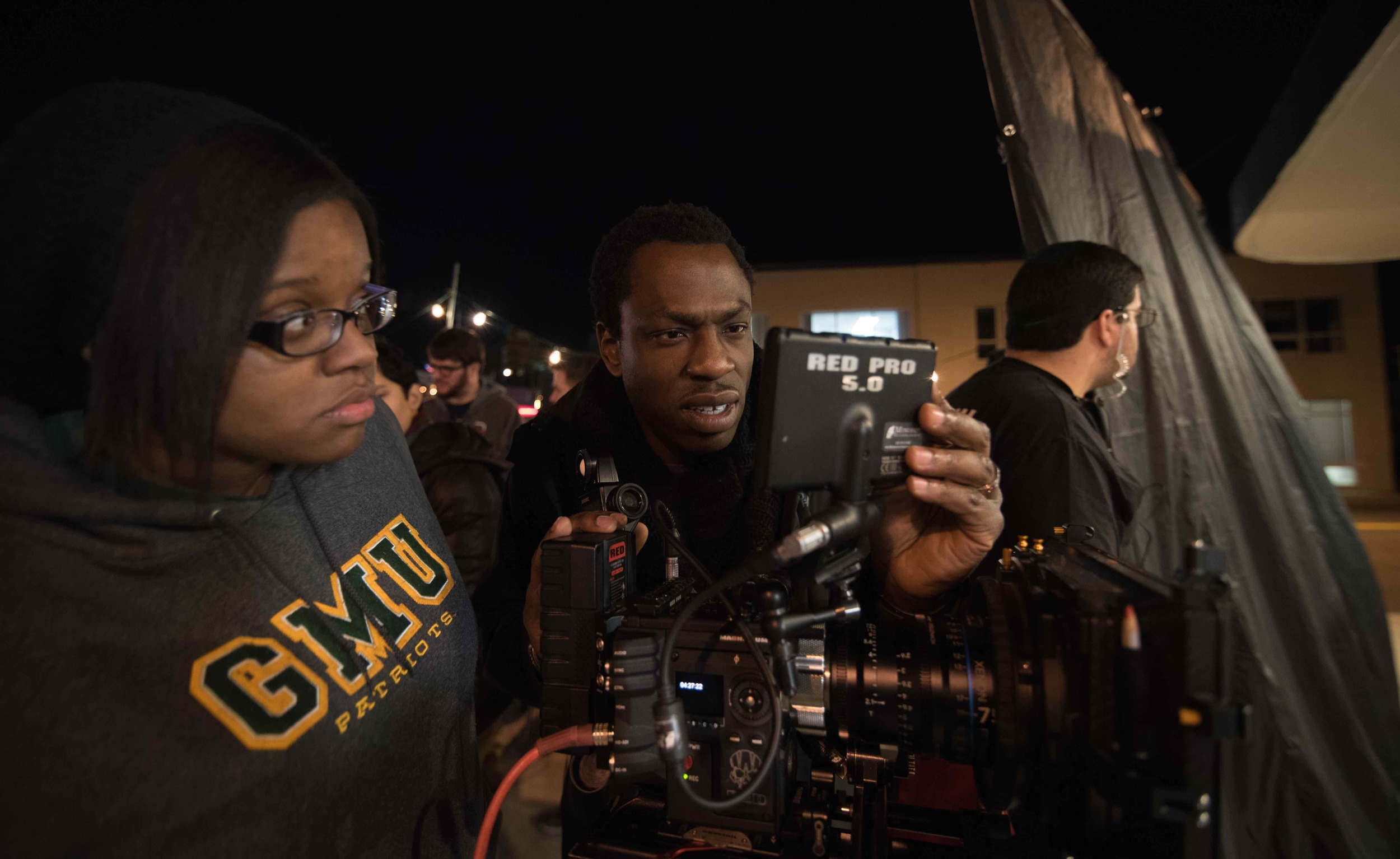 Cinematography student D'Andra Walsh and Cinematographer Hans Charles setting up the first shot in JAVA the short. Image by Dixie D. Vereen.