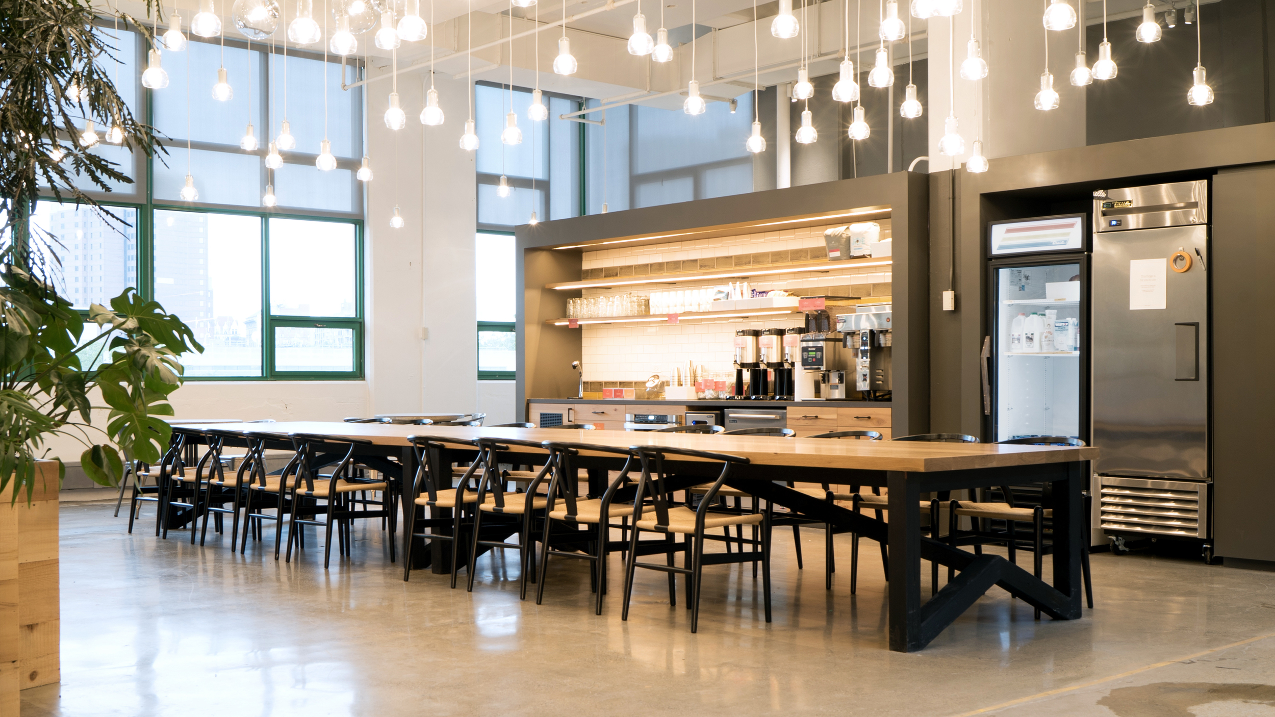 ONE OF TWO COMMUNAL DINING SPACES AT THE NEW ETSY HQ