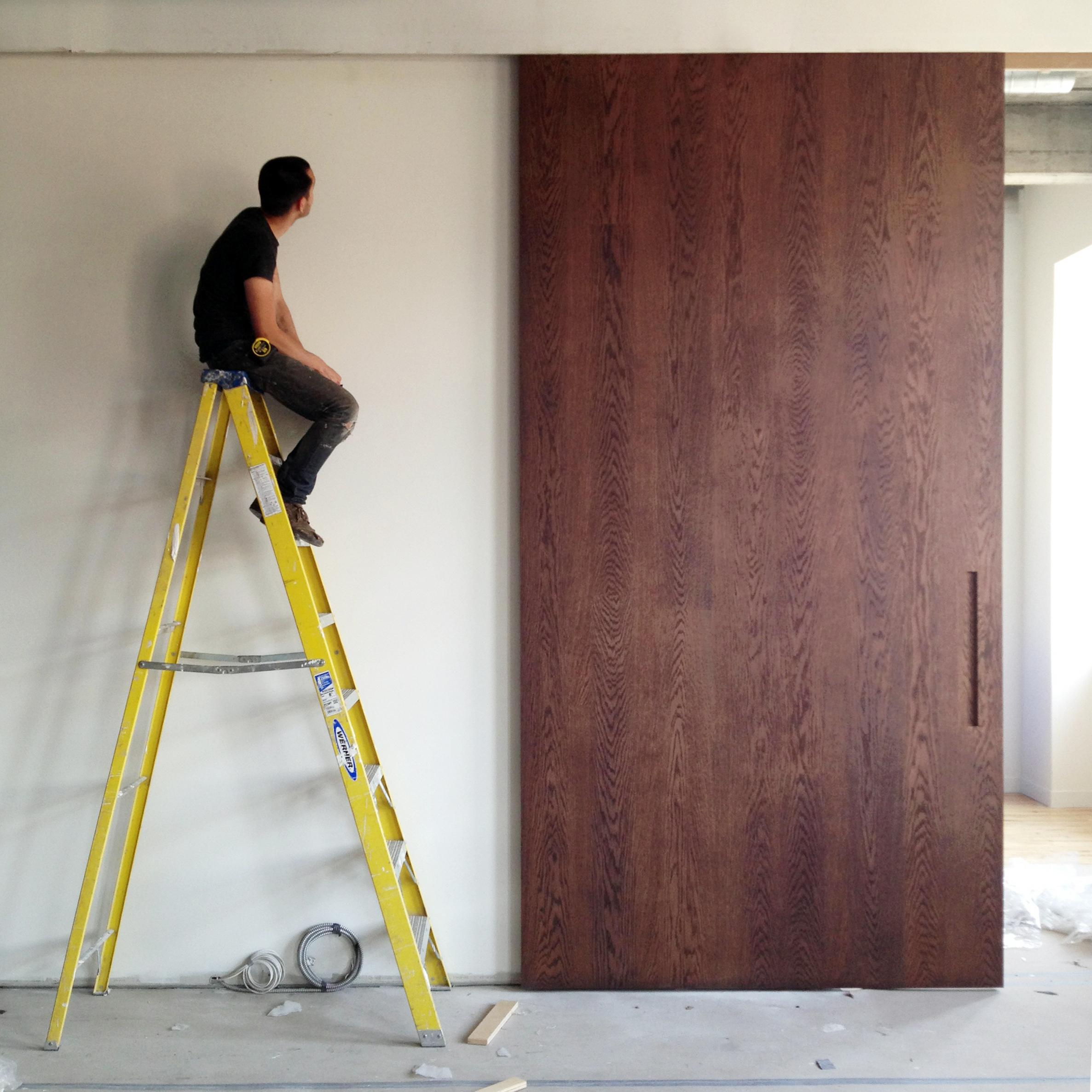 massive-sliding-door-in-white-oak