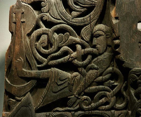 Gunnar gets killed by snakes while he plays a harp with his feet. Detail from Hylestad stave church in Setesdal, Norway.