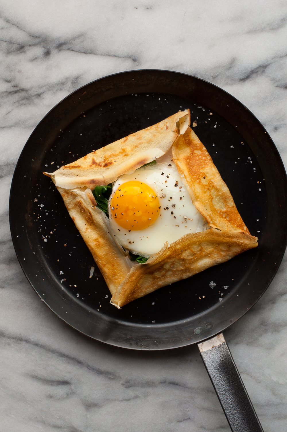 Savory Crepes With Cheese Spinach And A Fried Egg Amanda Frederickson