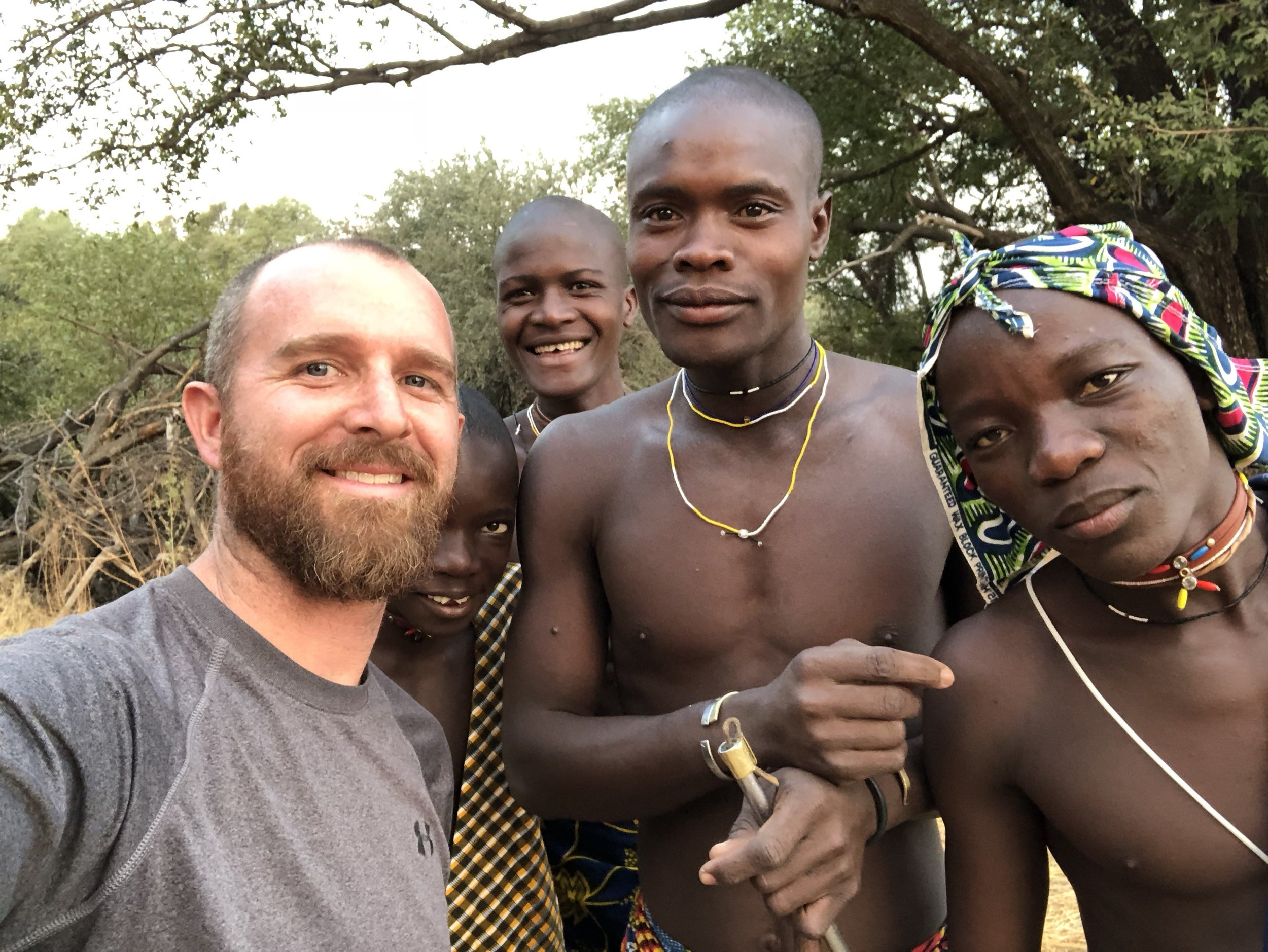 Jacob Schwertfeger with a nomadic tribe in Angola, known as the Mucabal tribe.