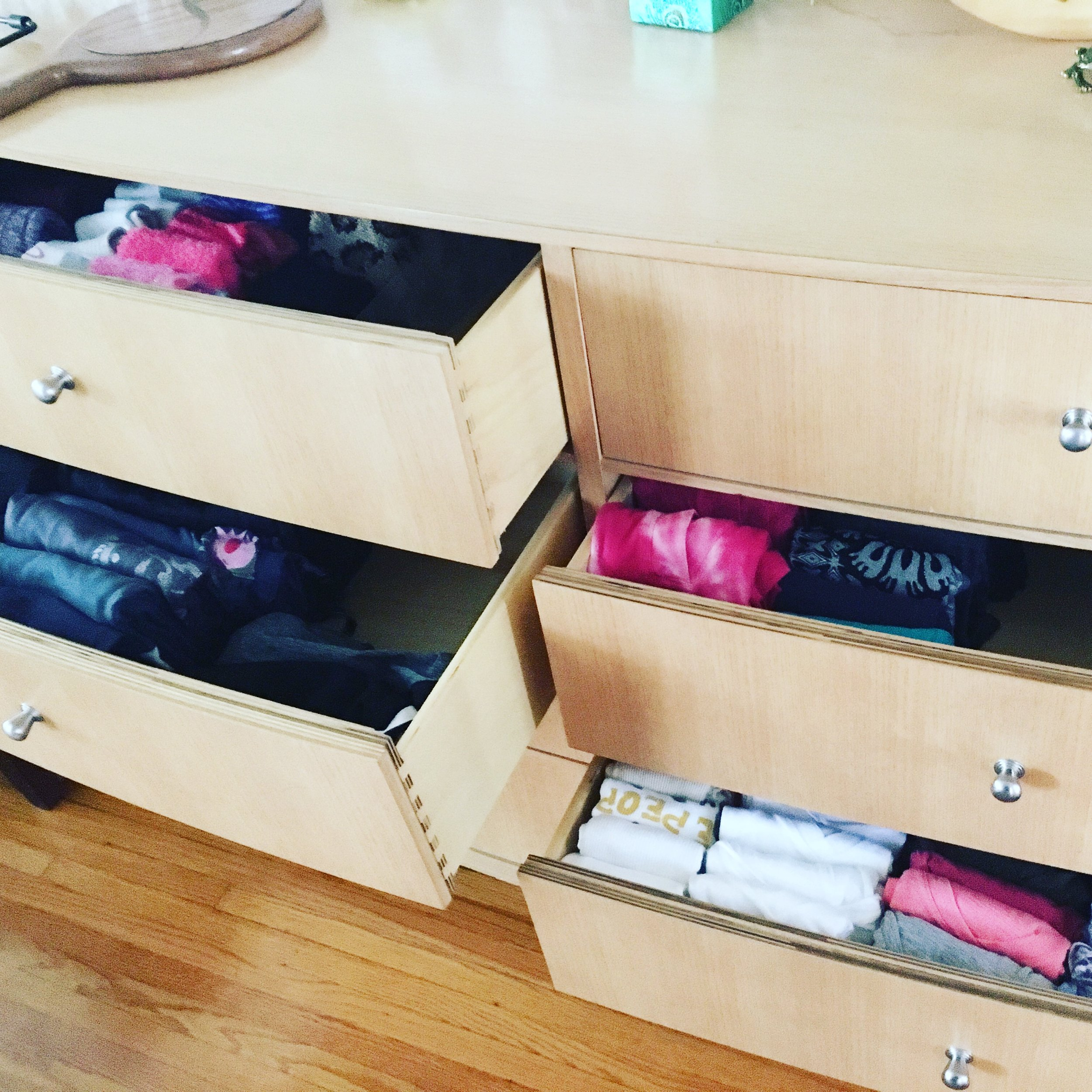 "Using the KonMari ""vertical"" fold, clients see clearly and can choose easily, the clothing in drawers. Uses space much more efficiently, too.  Having a system like this makes mornings effortless."