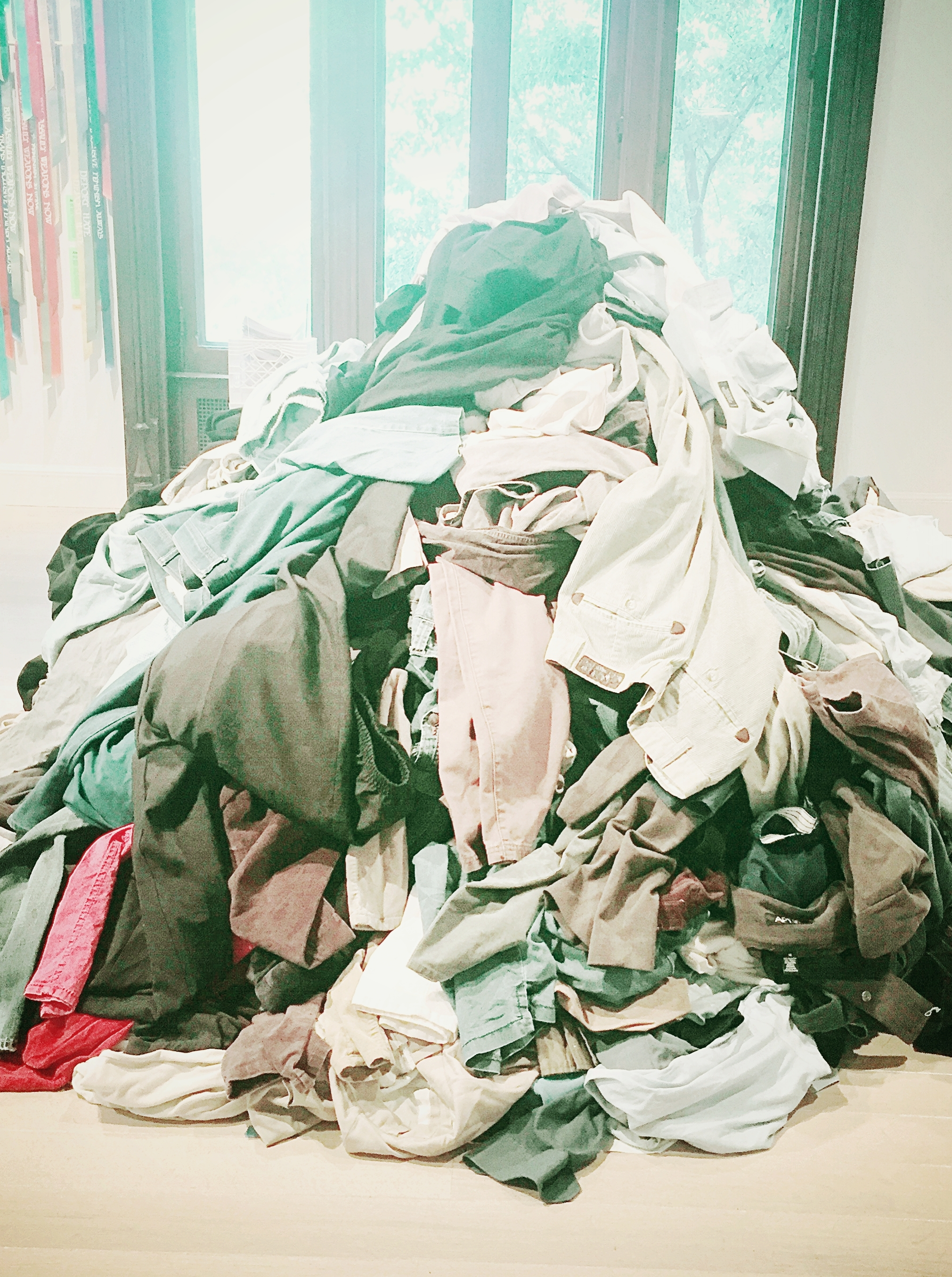 """The KonMari """"pile""""   By gathering clothing into one pile, before sorting, the sheer amount is impressive and informs decisions. This technique clears the closets, and other storage areas, so you get a fresh start at creating your ideal."""