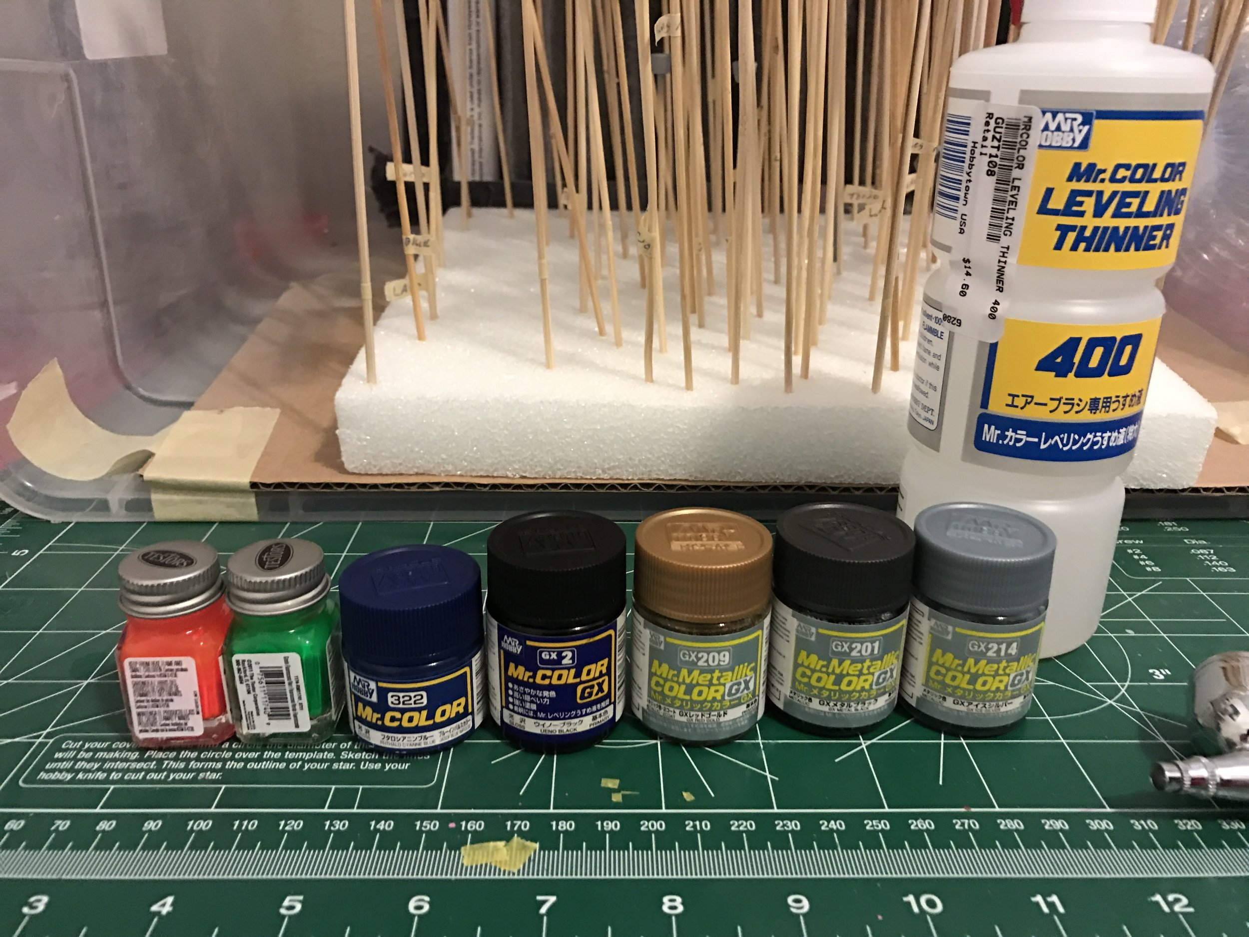 Here are the colors I'll be using. The metallics will be for the frame, weapons and maybe the face. The black and dark blue will be for the armor and and the fluorescents will be for panel lines.