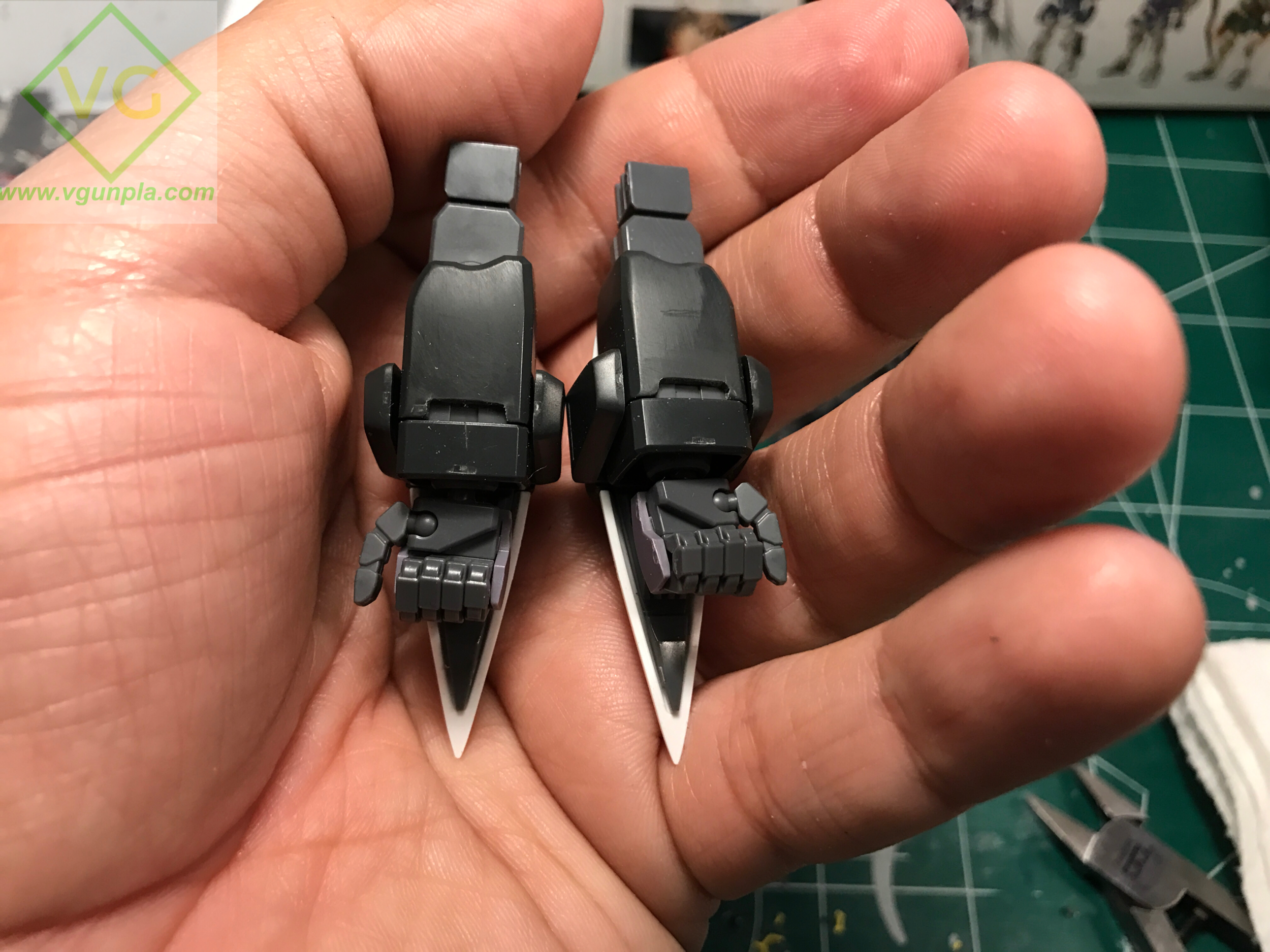I tried a little armor separation here. For this section I drew lines with a pencil where I wanted to cut away (that little rectangular gap between the cuff and the arm armor), then cut the plastic with my nippers and cleaned it up with a file, then hobby knife, then sanding. This adds breaks up the flat area above the hands and also gives a look at the inner frame.