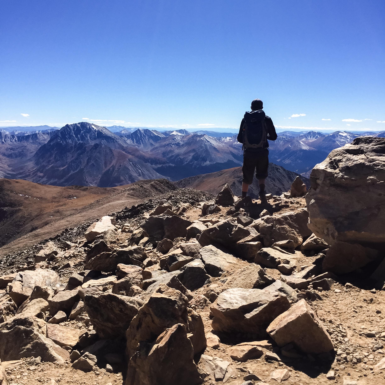 Fellow hiker peering out toward the Rockies