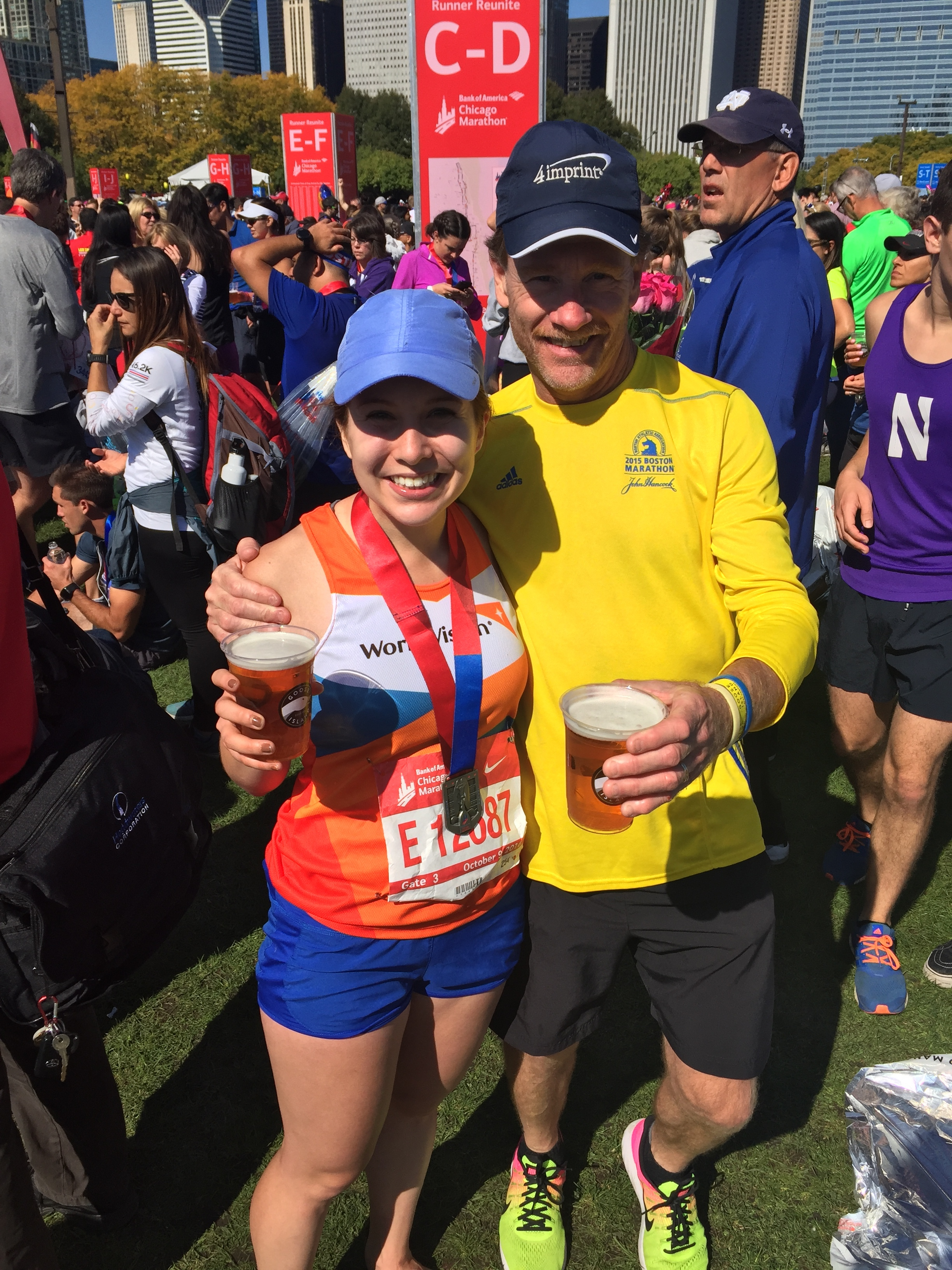 My dad & I at the 2016 Chicago Marathon Finish. This year he'll be rocking a medal around his neck too.