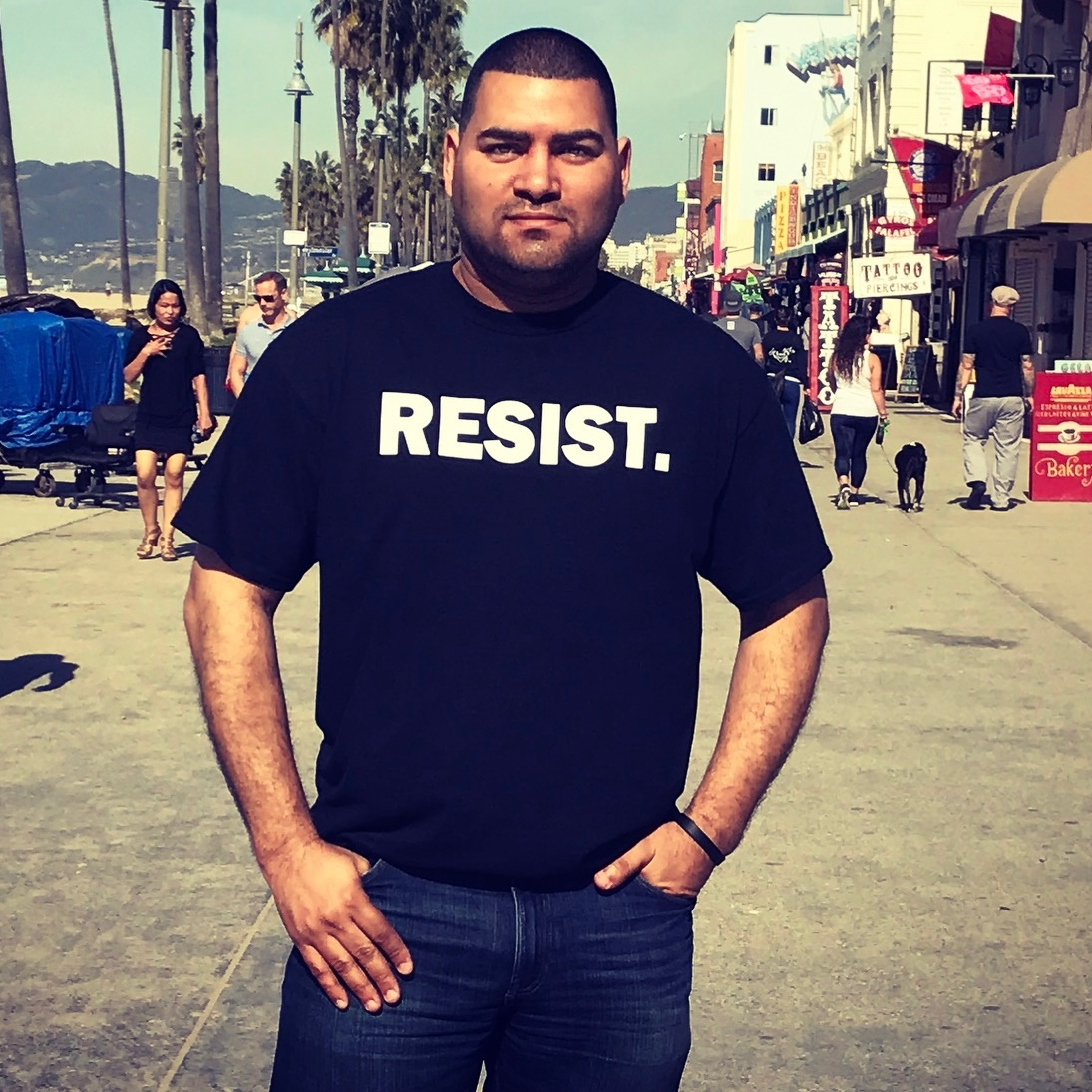 """This is the moment I decided to run for elected office. I took this picture on vacation in Venice Beach. I had a free day and decided to walk the neighborhood with my new """"Resist."""" shirt. It's not easy to walk around with such a bold statement on your chest, but I felt that people needed a reminder to stay woke. While I continue to be an activist, running for office was my way to ensure that more progressive voices are also being heard on the inside."""