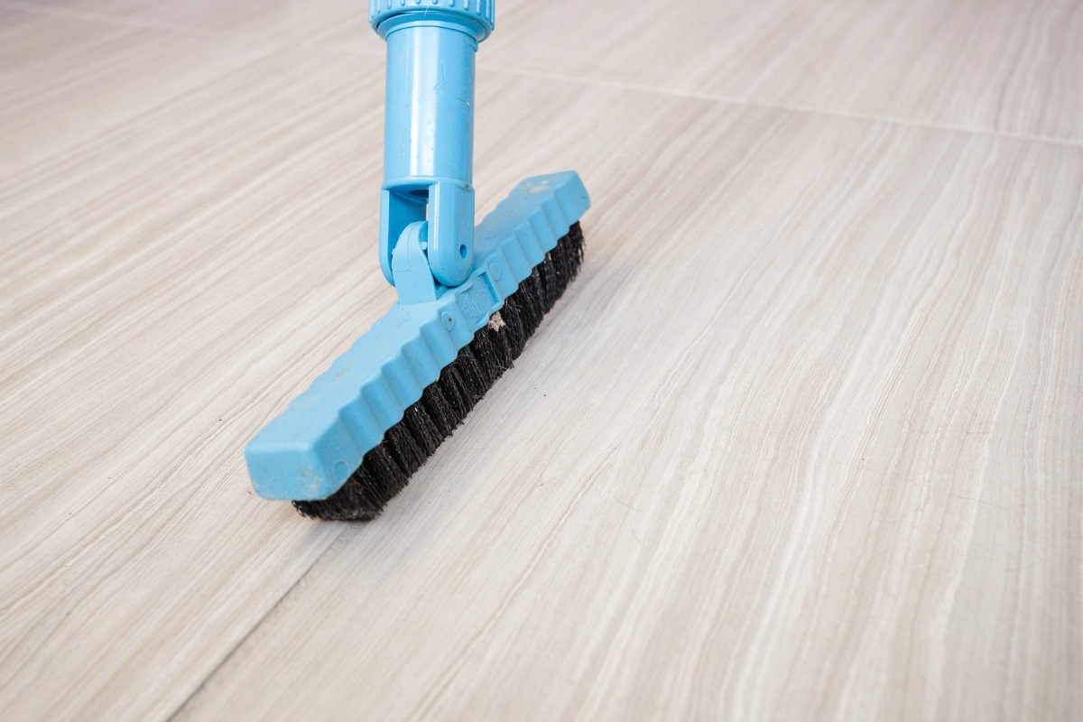 Cleaning tile with nylon brush | MrsGrout.com