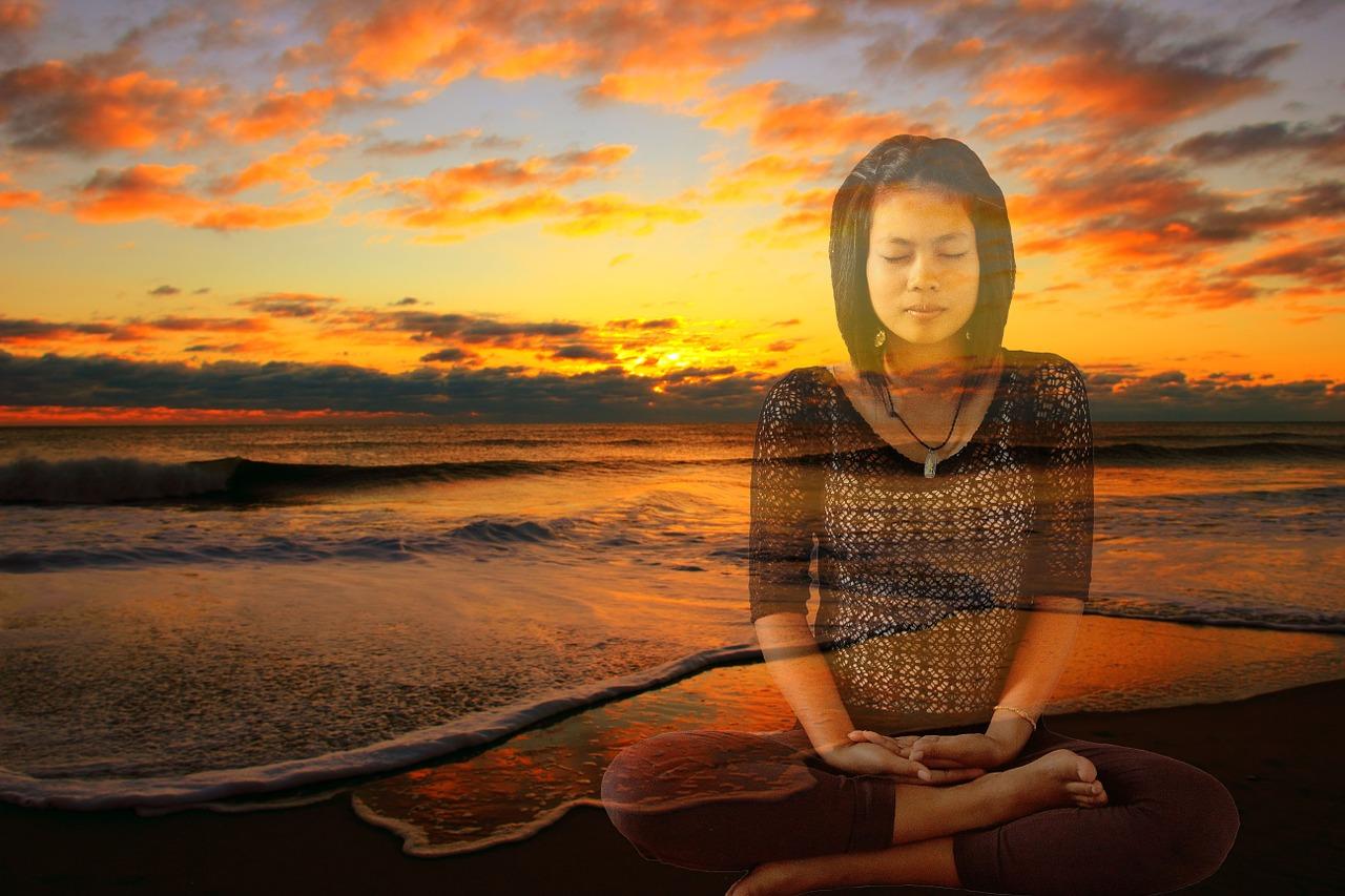 meditating woman and ocean.jpg