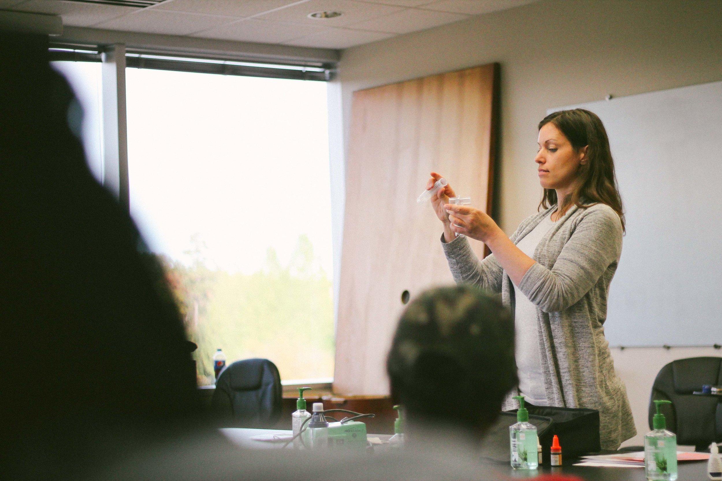 Julie Zeh, RN BSN training Good Neighbor direct support staff on medication aid.