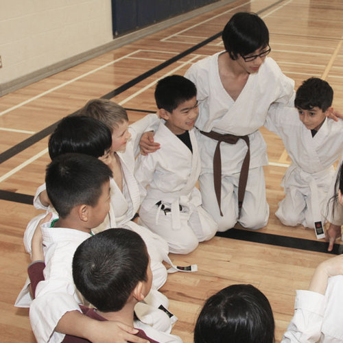 Young students tykes in class with instructors at Mind Over Matter Karate in North York, Toronto.