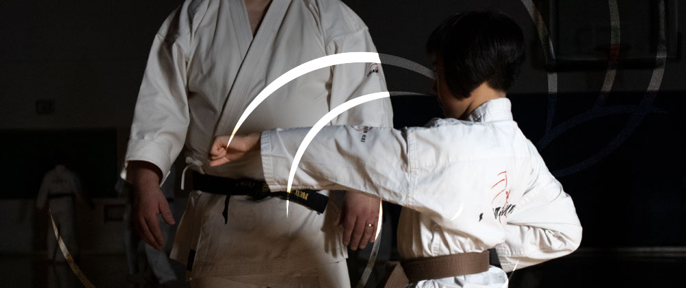 Student demonstrating forms with Sensei at Mind Over Matter Karate in North York, Toronto.