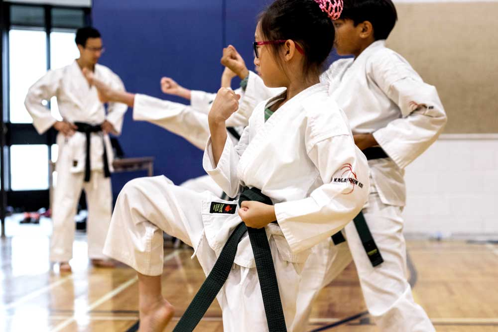 Young girl student practising karate at Mind Over Matter Karate in North York, Toronto.