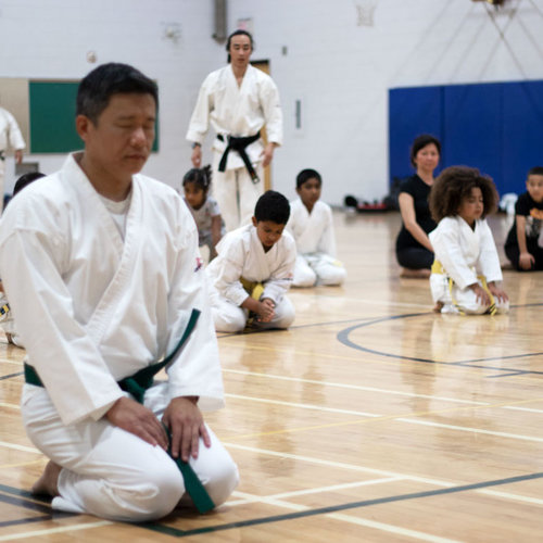 Adult and Children in Beginner Karate class at Mind Over Matter Karate in North York, Toronto.