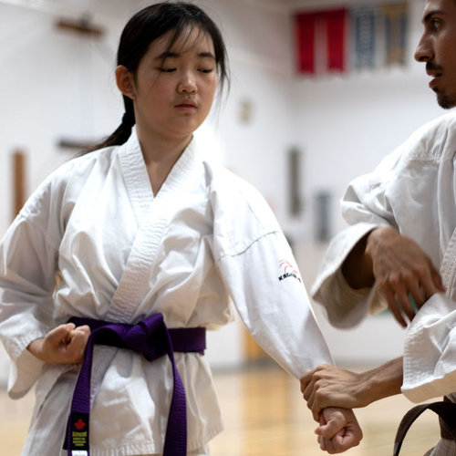 Two Advanced Karate students sparring at Mind Over Matter Karate in North York, Toronto.
