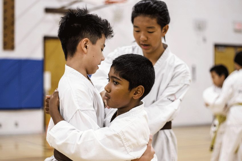 Two students sparring in karate class at Mind Over Matter Karate in North York, Toronto.