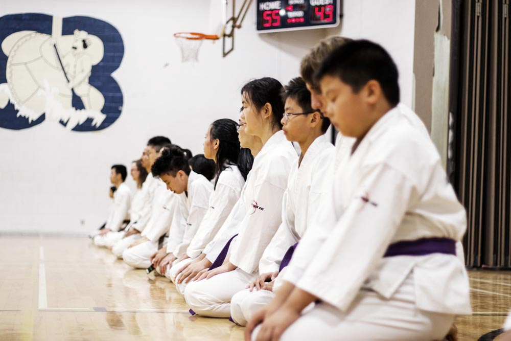 Students meditating at the end of class at Mind Over Matter Karate in North York, Toronto, On