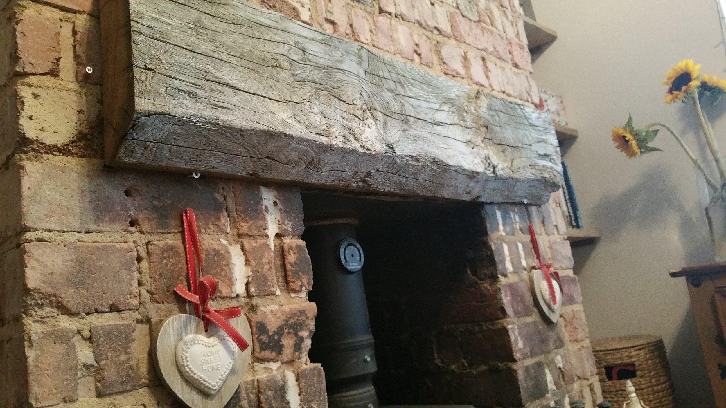 Reclaimed oak flat mantel.