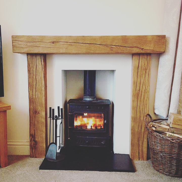 We can also offer full fire surrounds. This beautiful rustic fireplace surround is from old seasoned oak, hand worked and waxed to a stunning finish.