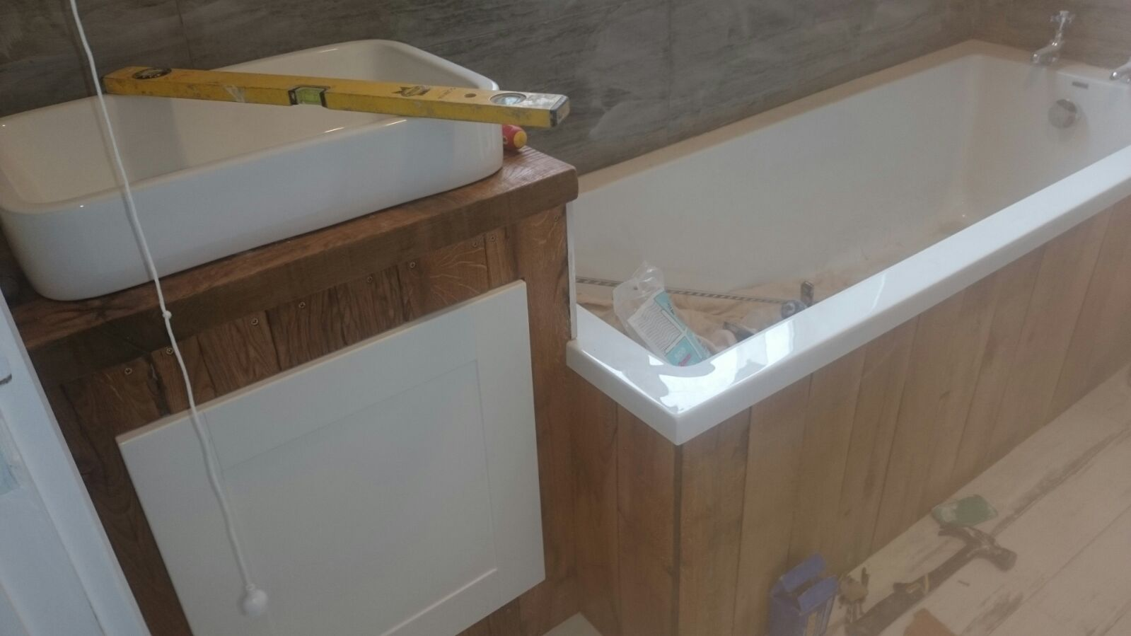 Fitting the door under the sink unit