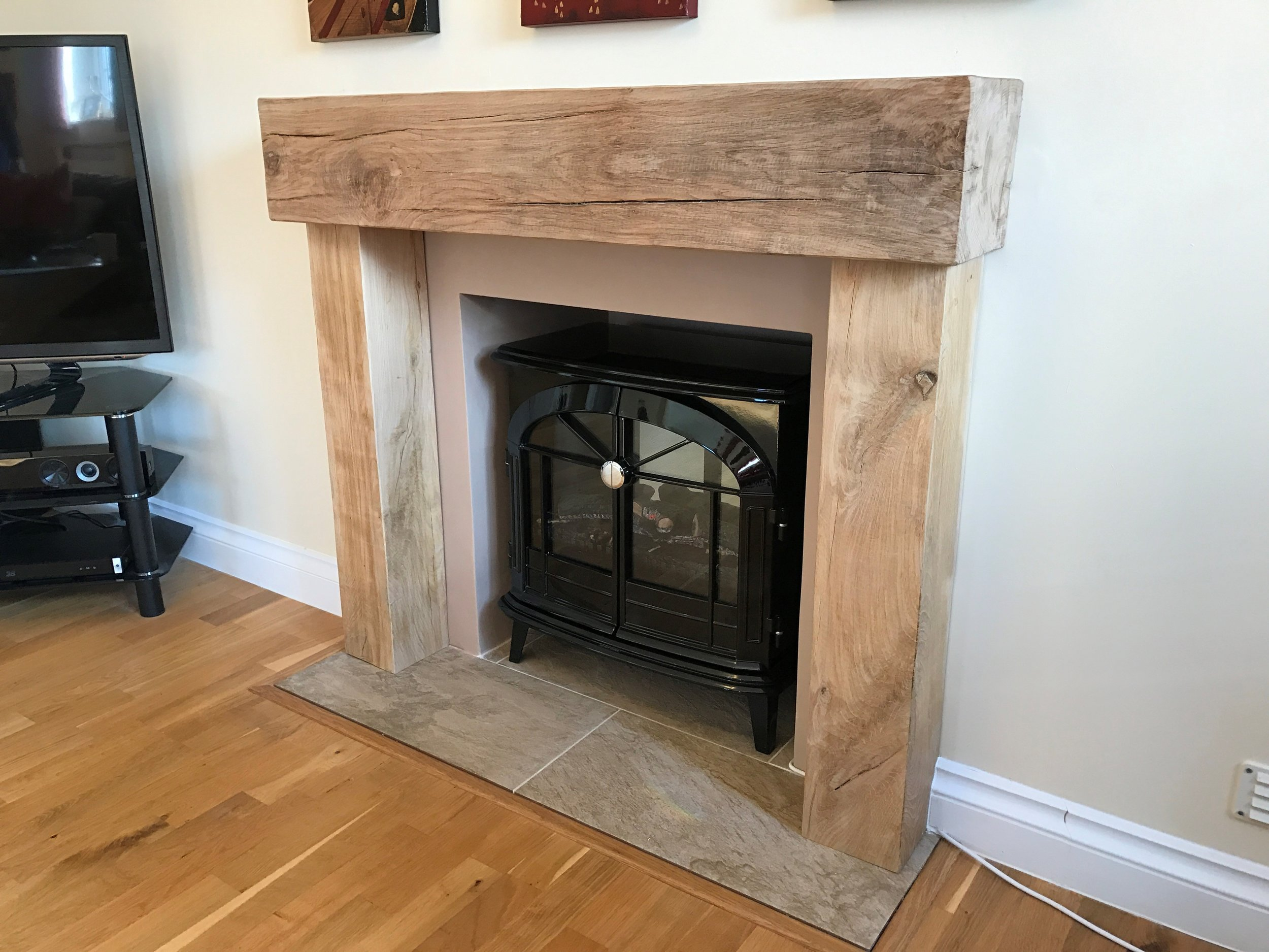 This air dried oak fire surround is plain triple sanded with a very slight chamfer. The client wanted contemporary styling with character. They were very happy with the finsihed product!