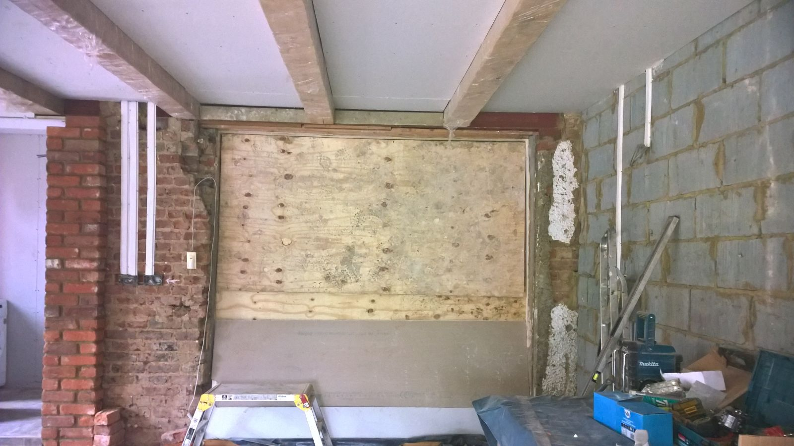 Here is the installation of the smaller oak beams
