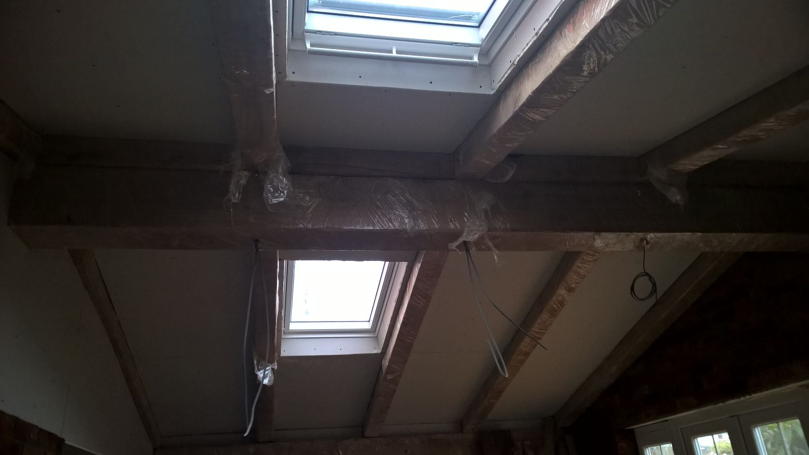 Here you see the beams and hollowed oak wrapped so the decoraters can work round