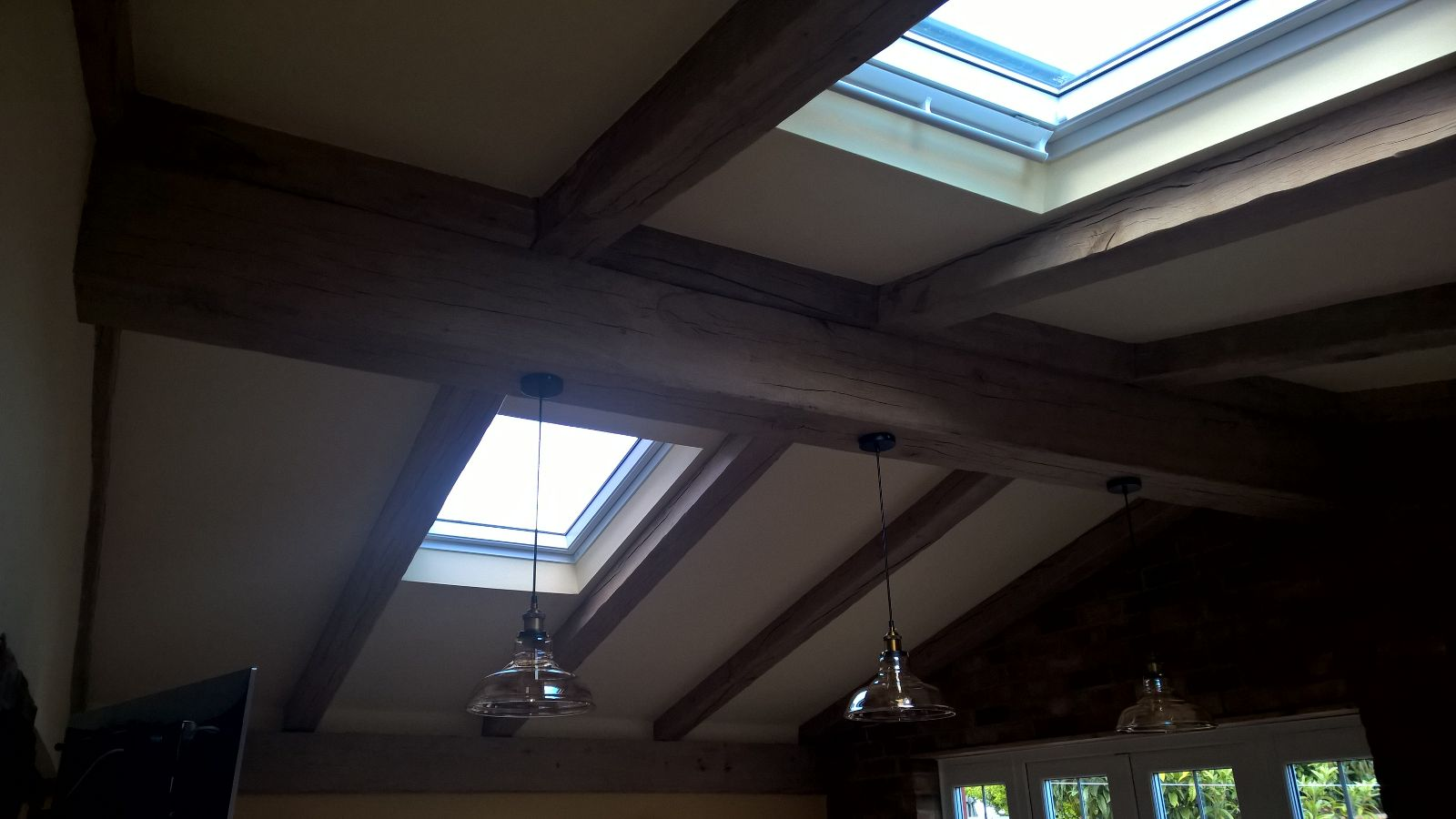 The same section of the ceiling finished with the covers removed. The oak looks stunning