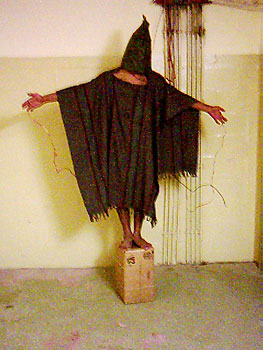 Ali Shallal al-Qaisi being tortured by American troops at Abu Ghraib Prison. Ali was told that if he fell off the box he was put on he would be electrocuted.