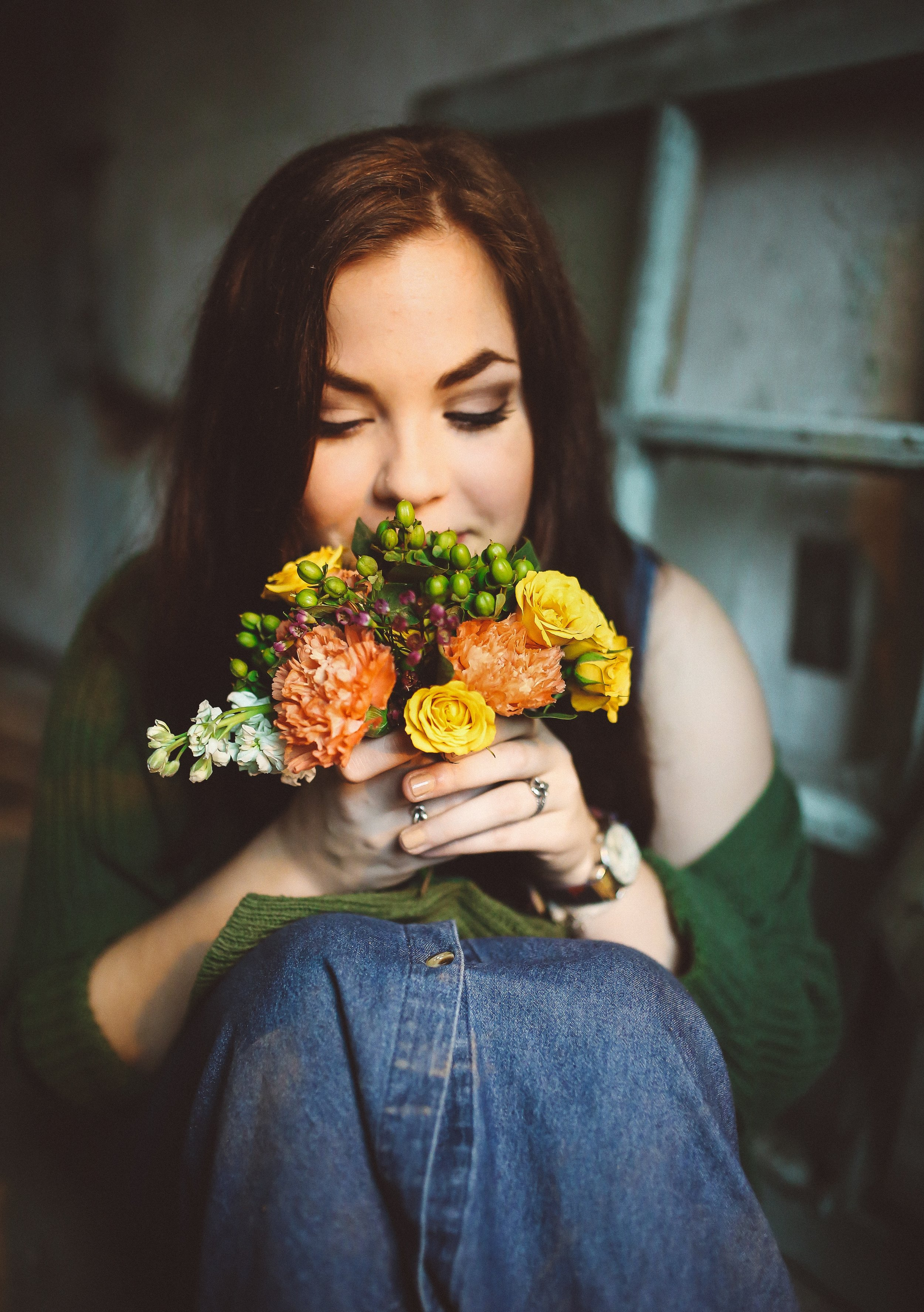 A Picture or a woman smelling the aroma of flowers - danielle-marroquin-16121.jpg