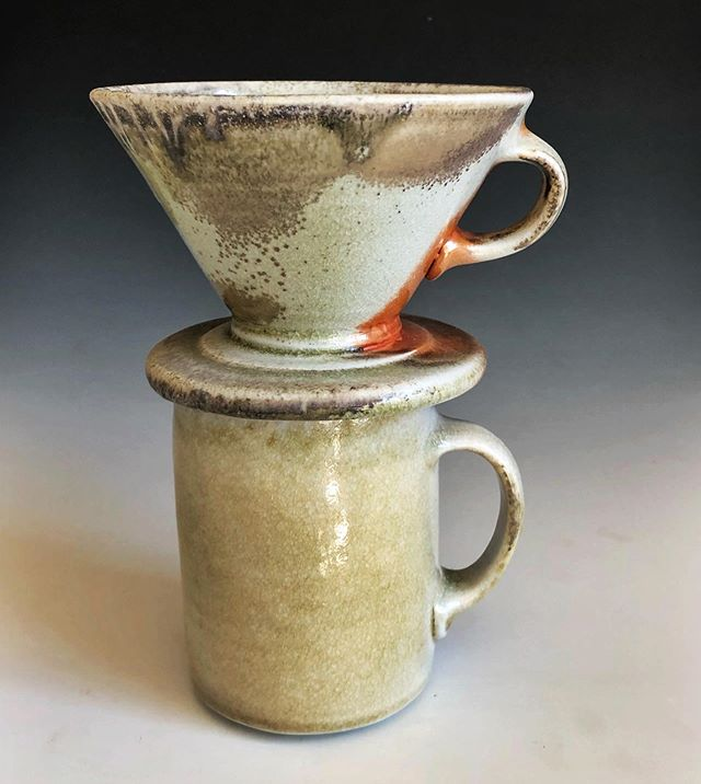 Really glad I snapped a photo of this pourover before it found a new home! This mug is still available @clayspaceasheville  And... my booth is fully stocked (finally!) @atomic_furnishing in Asheville (off Swannanoa River road!). Lots of great mugs and pourovers available there, too! #woodfiredpottery #mug #pourovercoffee #porcelain #shino #shinoshiyes #shinoshegood #clayspacecoop #atomiccommunity