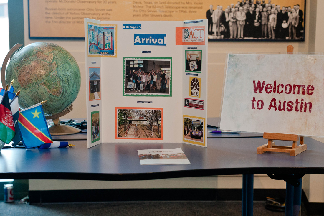 Tables hosted by Caritas and RST focused on different aspects of a refugee's journey, beginning with his/her life before coming to the United States and culminating with the process of becoming an American citizen.